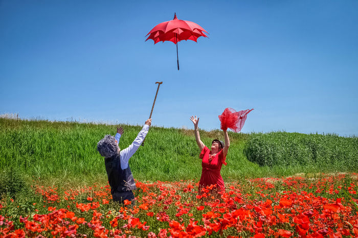 Red & red Two People Red Fun Human Body Part Outdoors Day Mid-air Summer Lovely Flower Colors Tuscany Red Red Umbrella Gildo Masini Fuji X-T1 LollyLove Eyem Vision Umbrella Adults Only Rural Scene Dream Poppies  Two People Alone In Nature