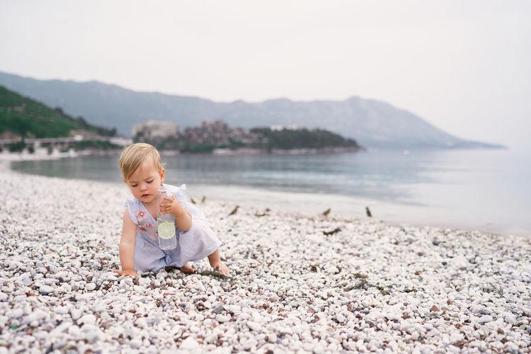 Full length of cute boy on beach