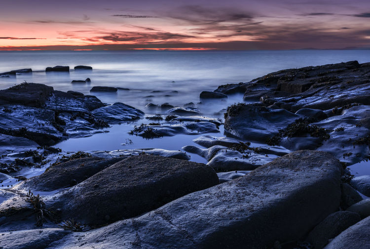 Darkness off the coast Sea Water Sky Sunset Beauty In Nature Scenics - Nature Beach Horizon Over Water Rock Tranquility No People Rocky Coastline Outdoors Nature Night Blue Hour Huế Rugged Waves Long Exposure Weather Seascape Season  Dark Rich