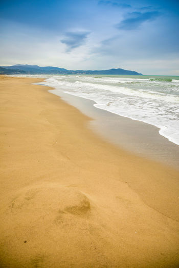 Italy Beach Land Sea Water Sand Sky Cloud - Sky Scenics - Nature Aquatic Sport Wave Surfing Tranquility Beauty In Nature Nature Sport Tranquil Scene Motion Day Outdoors Horizon Over Water