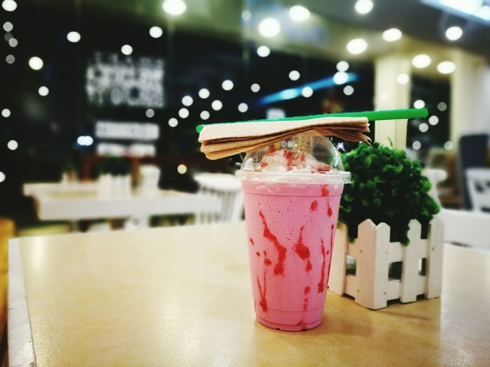 a quiet milkshake moment... Drink Smoothie Refreshment Drinking Straw Freshness No People Indoors  Close-up Blended Drink Cold Temperature Mobile Photography HuaweiP9plus Huawei P9 Plus City Life Taking Photos Huaweimobile Open Edit Strawberry Shake  Huawei Wide Aperture Huaweiphotography Huawei Photography Kokopaps Eyeem Philippines