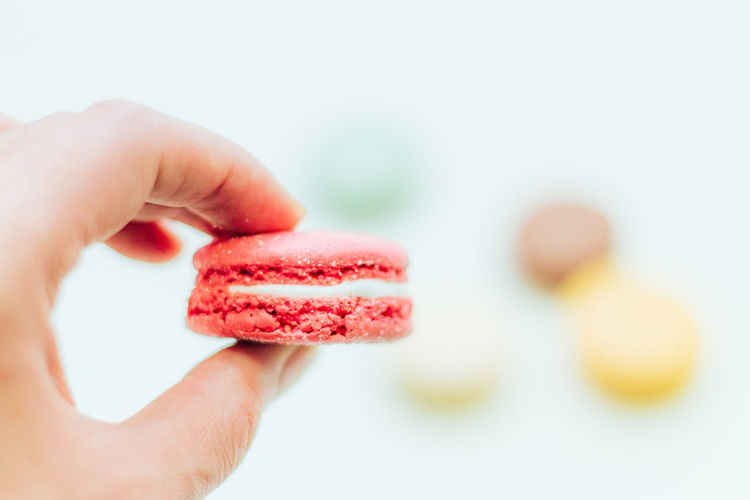 Cropped Hand Holding Macaroon