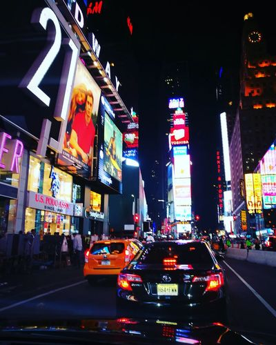Times square Night Illuminated City City Street Travel Destinations Red City Life Traffic Car Transportation Skyscraper Road Yellow Taxi Architecture Outdoors Nightlife Neon Cityscape Sky Horizontal