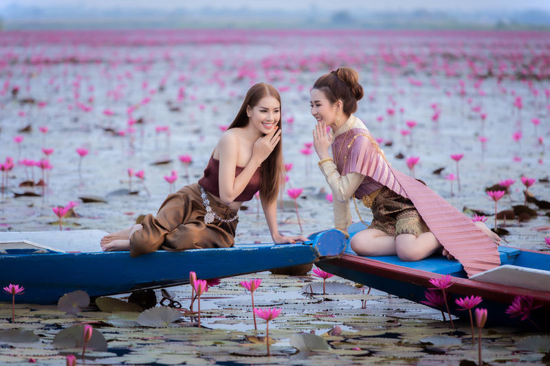 Women sitting on pink water at park
