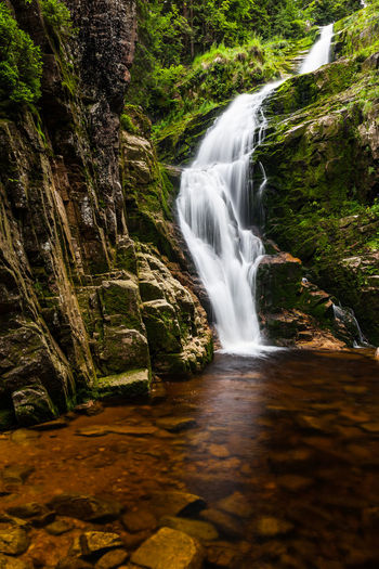 Kamienczyk Waterfall. Sudetes. Poland Kamieńczyk Waterfall Karkonoski Park Narodowy Karkonosze Sudety Beauty In Nature Blurred Motion Day Flowing Water Forest Kamieńczyk Waterfall Karkonski Park Long Exposure Motion Nature No People Outdoors Scenics Sky Sudetes Tranquil Scene Tree Water Waterfall