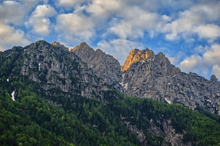 Sunrise at Julian Alps Vrsic Pass Affinity Photo Alps Beauty In Nature Cloud - Sky Environment Formation High Julian Alps Landscape Mountain Mountain Peak Mountain Range Nature No People Outdoors Rock Rock - Object Scenics - Nature Sky Slowenia Solid Sunrise Tranquil Scene Tranquility