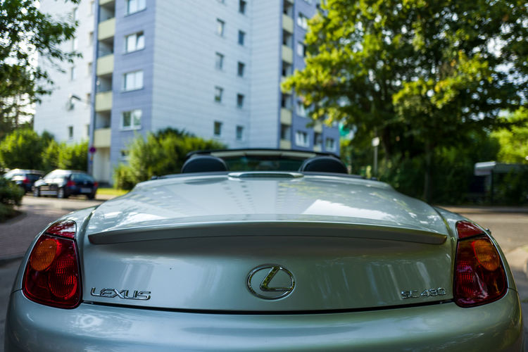 Lexus SC 430 SC430 Architecture Building Exterior Built Structure Car City Close-up Day Focus On Foreground Land Vehicle Mode Of Transportation Motor Vehicle No People Outdoors Plant Retro Styled Street Taxi Transportation Tree