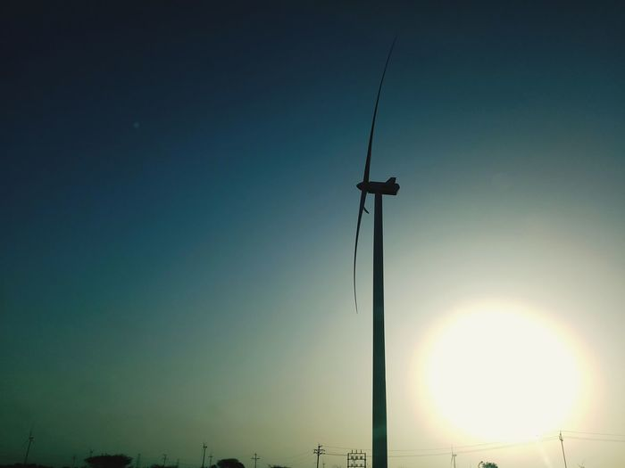photo by. shivang mevada Power From Nature Power In Nature 10no. Shadow Shadows & Lights Sky Farmland Landscape_photography Sun Sunrise Black Yellow Sunlight And Shadow Windfarm 10 Electricity Tower Windmill Renewable Energy Electricity  Shining