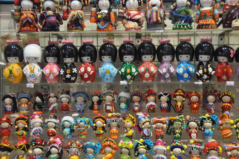 Arrangement Chinese Dolls Choice Collection Dolls For Sale Large Group Of Objects Market Multi Colored No People Order Retail  Shelf Shop Side By Side Small Business Still Life Store Variation