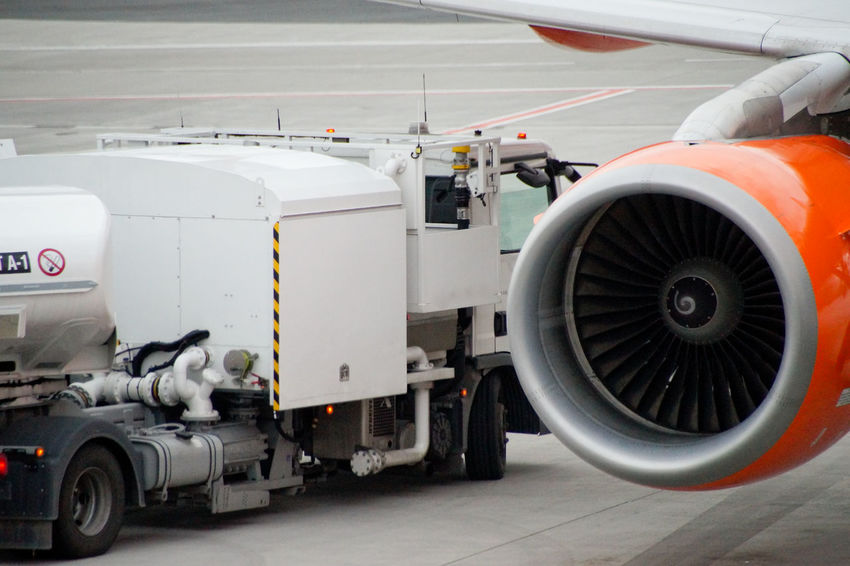 Aerospace Industry Air Vehicle Airplane Airport Airport Runway Art Is Everywhere Break The Mold Close-up Commercial Airplane Commercial Land Vehicle Day Jet Engine Land Vehicle Mode Of Transport No People Outdoors Stationary TCPM Transportation
