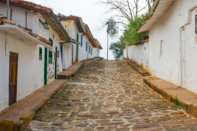 Architecture Building Building Exterior Built Structure Cobblestone Colombia Day Diminishing Perspective House Narrow No People One Point Perspective Pathway Peaceful Picturesque Street The Way Forward Tourism Traveling Vanishing Point Village Village Life White Walls