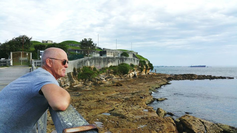 Pondering the big questions like..... Perspective Telling Stories Differently Calmness Water Rocks And Water Meditation Casual Clothing Sunglasses Side View Clouds And Sky Contemplating Mature Man Focus On Foreground Ocean View