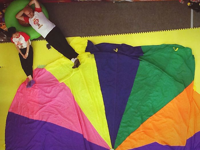Real People Multi Colored Indoors  Day People Rainbow Colors Parachute Directly Above Pattern