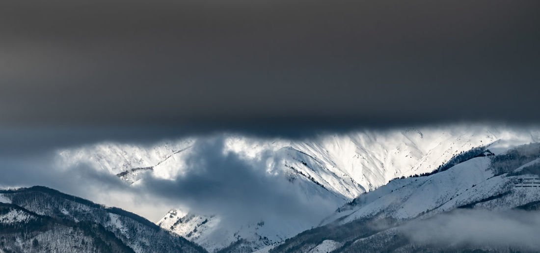 Snow Cold Temperature Winter Mountain Environment Scenics - Nature Nature Beauty In Nature Sky Landscape Storm Copy Space Cloud - Sky No People Panoramic Mountain Range Outdoors White Color Snowcapped Mountain Mountain Peak Above