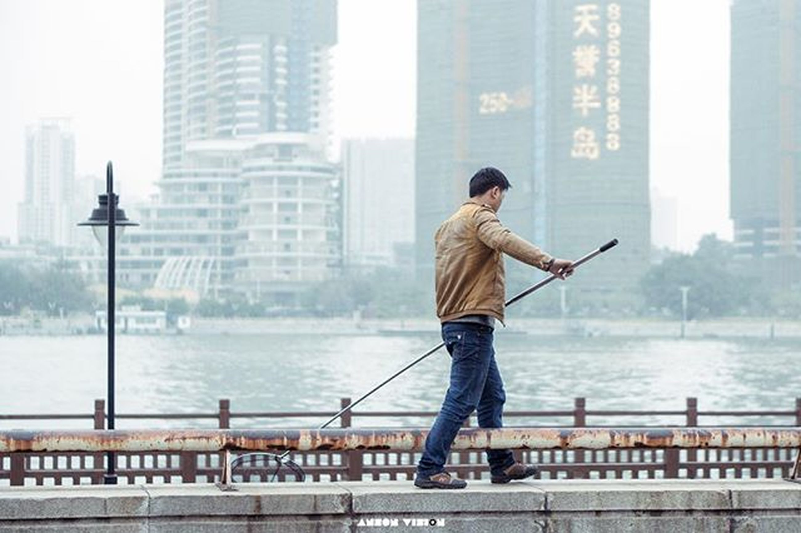 water, rear view, full length, built structure, standing, building exterior, lifestyles, architecture, city, railing, leisure activity, sea, casual clothing, men, three quarter length, river, city life, sky