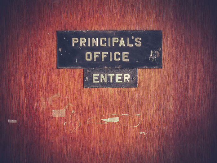 Retro Filtered Image Of A Grungy Principal's Office Door At A Public School In The USA Headmaster Kids Public Transportation Retro Sign Students Wood Youth Administration Childhood Classroom Door Education Grunge Headshot Office Building Principal School Teacher Teachers Trouple Vintage Wooden Worn