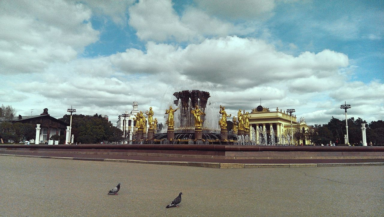 sky, statue, cloud - sky, architecture, sculpture, built structure, animal representation, history, travel destinations, outdoors, building exterior, travel, day, motion, water, no people, nature, animal themes, city, bird, carousel