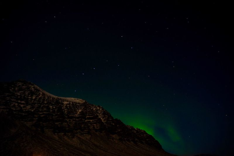 Low angle view of mountain against clear sky at night