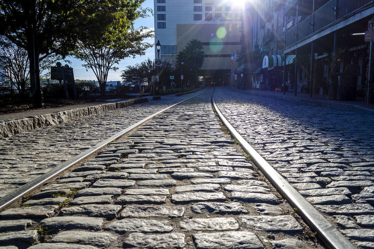 Railroad tracks by street in city
