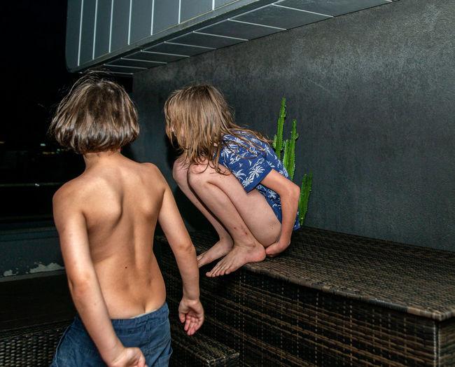 Rear view of shirtless boy