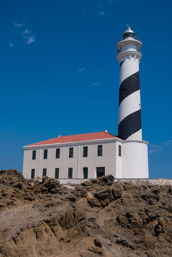 Light Lighthouse SPAIN Architecture Blue Building Building Exterior Built Structure Day Direction Guidance Landmark Lighthouse Low Angle View Menorca Nature No People Outdoors Protection Rock Rock - Object Safety Security Sky Tower