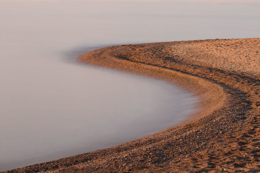 S Water Sunrise Morning Light Shape Shapes In Nature  Shapes And Forms Nature Tranquility No People Calm Scenics Long Exposure Curve Water Sunset Sky Sand Dune Lakeside Atmospheric Sand Sandy Beach FootPrint Calm
