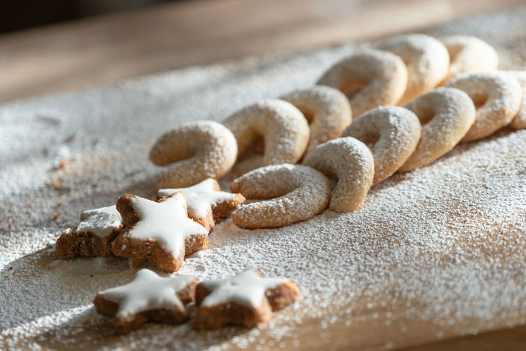 High angle view of cookies in flour on table