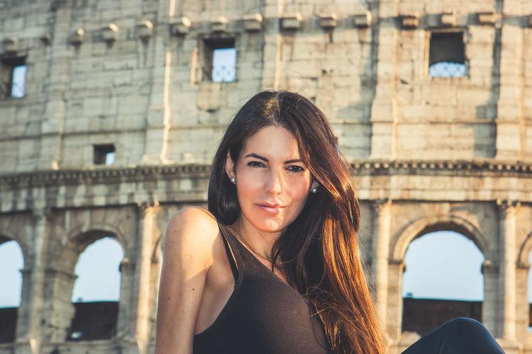 Portrait of woman against historic building