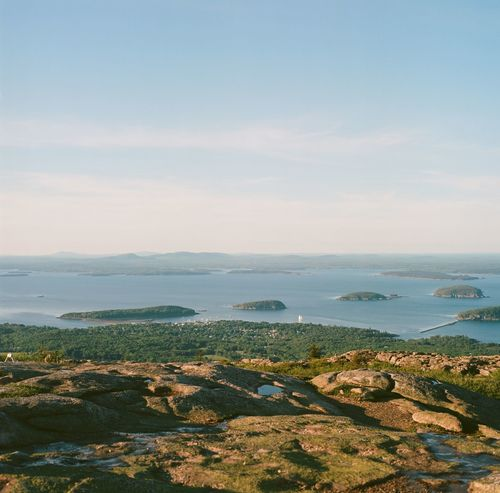 Looking down over Bar Harbor from the top of Cadillac Mountain. Acadianationalpark Atlantic Ocean Beauty In Nature Blue Blue Sky Clear Sky Coastline Day Exploring Hasselblad Horizon Over Water Maine Majestic New England  Outdoors Perspective Physical Geography Remote Scenics Sea Summer Top Perspective Tranquil Scene Tranquility