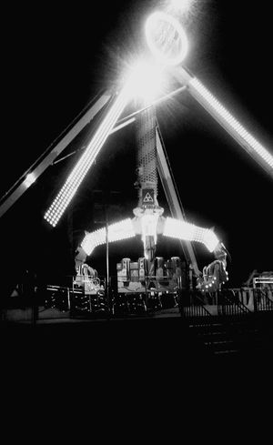 Fairground Amusement Park Night Arts Culture And Entertainment Illuminated Amusement Park Ride No People Outdoors Blackandwhite Politics And Government Cityscape EyeEmNewHere City Outside Photography Eyemphotography Nightlife Architecture Sky Built Structure Event Arts And Entertainment Illuminationphotography Excitement Neon Lights Nightphotography