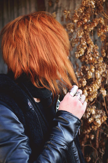 Close-Up Of Woman With Redhead Wearing Leather Jacket