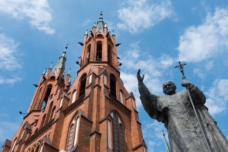 Cathedral Bialystok Poland Architecture Bell Tower Bialystok Building Exterior Built Structure Cloud - Sky Cross Day History Low Angle View No People Outdoors Religion Sculpture Sky Spirituality Statue Travel Destinations