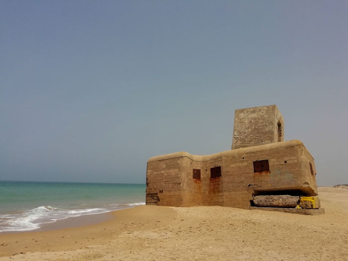 Bunker Architecture Beach Building Building Exterior Built Structure Bunkers  Clear Sky Copy Space Day History Horizon Horizon Over Water Land Nature No People Outdoors Sand Scenics - Nature Sea Sky Water