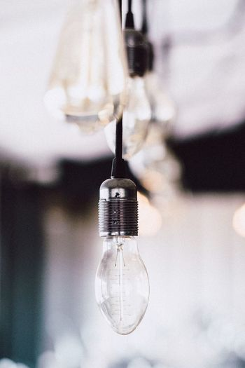 Close-Up Of Light Bulb Hanging At Home