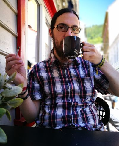 Needs of the day. Coffee Coffee And Cigarettes Coffee Time Colors Man Plant Smoke Close-up Coffee Break Day Eyeglasses  Holding One Person Outdoors People Shirt Young Adult This Is Masculinity The Portraitist - 2018 EyeEm Awards