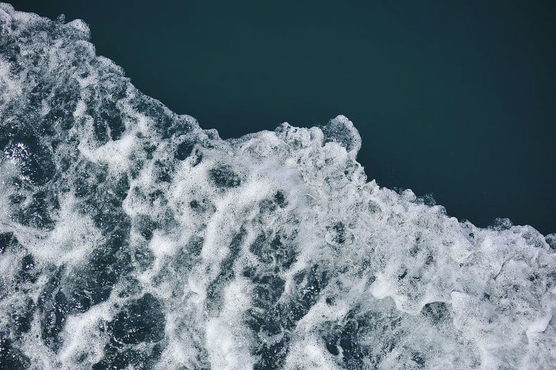 Close-up of waves on sea against sky