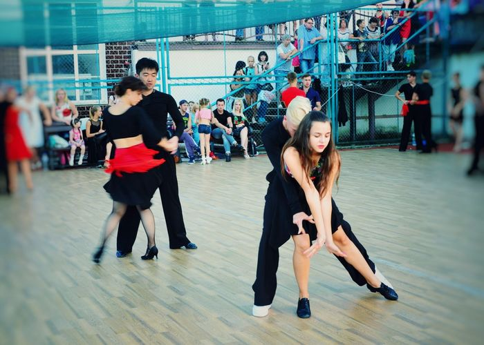 Sport Large Group Of People Competition Togetherness Crowd Fan - Enthusiast Sportsman Outdoors Performance Dance Floor Dancer Ballroom Dancing Skill  Music Arts Culture And Entertainment Teamwork Dance Dancing Lifestyles Women Young Men Leisure Activity Young Adult Enjoyment Motion