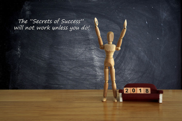 Win and Success of the Year 2018 Concept. Wooden mannequin on table with a chair. Business Growth Mannequin Maxim Slogan Writing Blackboard  Blackboard  Businessman Chalk Drawing Chalkboard Concept Goal Human Human Hand Leadership Message person Recruit Resources Success Toy Win, Wood - Material Year