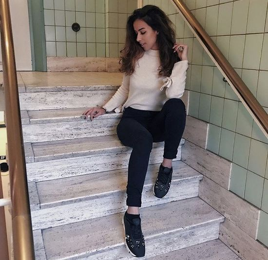 Portrait of young woman on staircase