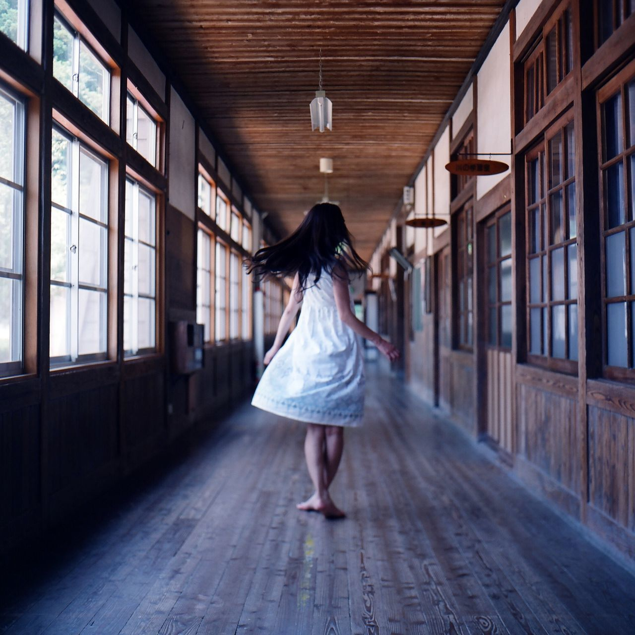 Woman Spinning In Corridor