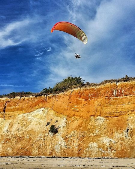 Extreme Sports Flying Parachute Sky Outdoors Cloud - Sky Sport Day Adventure Leisure Activity Paragliding One Person Motion People Nature Multi Colored