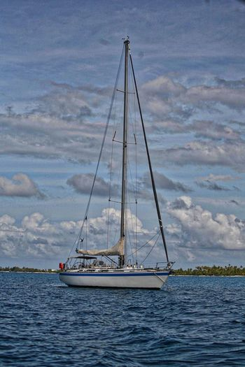 Sailing Yacht at anchor Nautical Vessel Transportation Sailboat Water Sea Mode Of Transportation Sailing Cloud - Sky Sky Travel Nature Mast Sailing Ship Beauty In Nature Ship Waterfront Outdoors