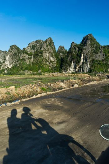 Exploring Vietnam by scooter is definitely one of the best ways of exploring the country. The roads are awesome, the landscapes unbelievably beautiful and the distances manageable. Motorcycle Scooter The Traveler - 2018 EyeEm Awards Beauty In Nature Clear Sky Day Land Landscape Mountain Nature Outdoors Road Road Trip Scenics - Nature Shadow Transportation Empty Road Country Road Rock Formation Eroded Rugged Vehicle Geology