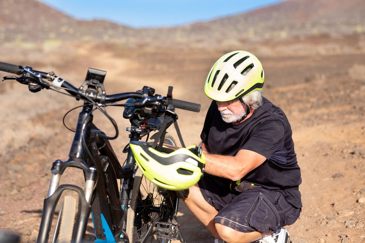 Man with bicycle on land