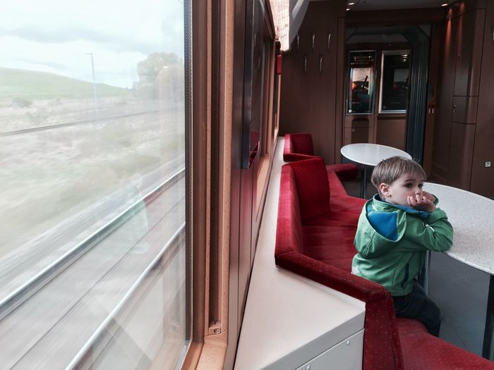 Boy Train Traveling Kid Thinking Lonely Window Tracks