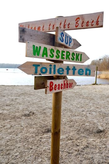 Sign Text Western Script Sand Communication Capital Letter Beach Road Sign Outdoors Travel Destinations Water Close-up
