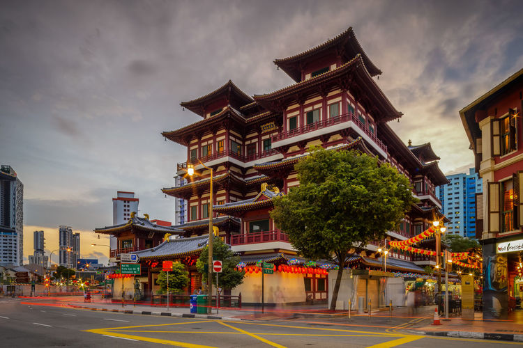 Buddha Tooth Relic Temple and Museum Buddha Tooth Relic Temple And Museum Chinatown Cityscape Nikon Travel Tree Architecture Building Exterior Built Structure Car Trails City Cloud - Sky Clouds And Sky Day Long Exposure No People Outdoors Road Samyang Sky Skyscraper Street Sunset Transportation Tree