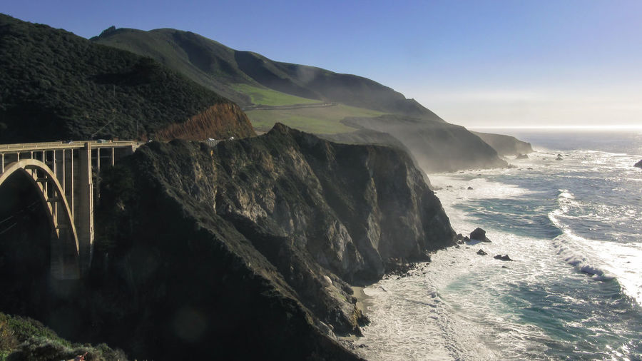 Beauty In Nature Bixby Bridge Clear Sky Cliff Day Horizon Over Water Mountain Nature No People Outdoors Physical Geography Rock - Object Rock Formation Scenics Sea Sky Sunlight Tranquil Scene Tranquility Water Wave