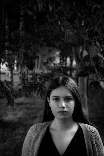 Portrait Of Young Woman Standing In Park
