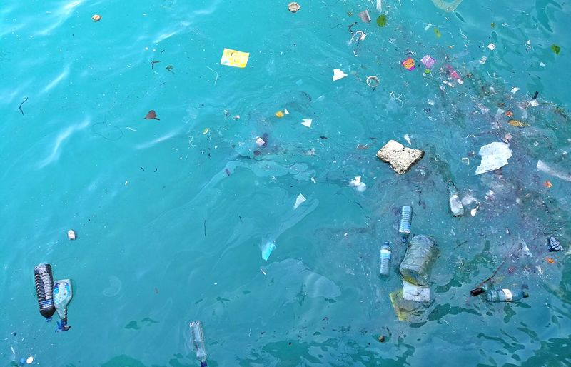 High angle view of garbage floating on water